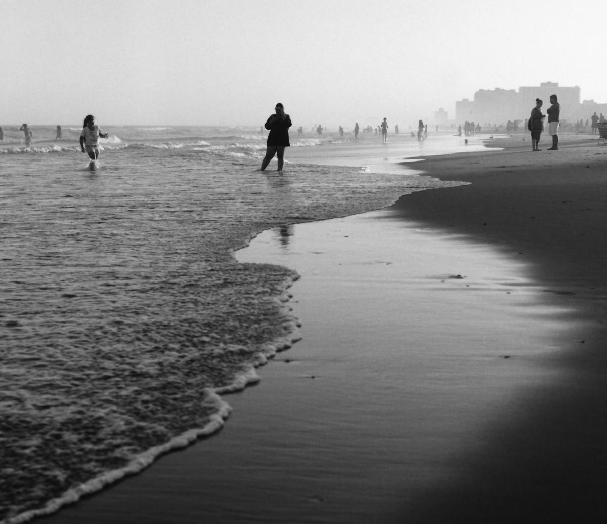 people on waters edge
